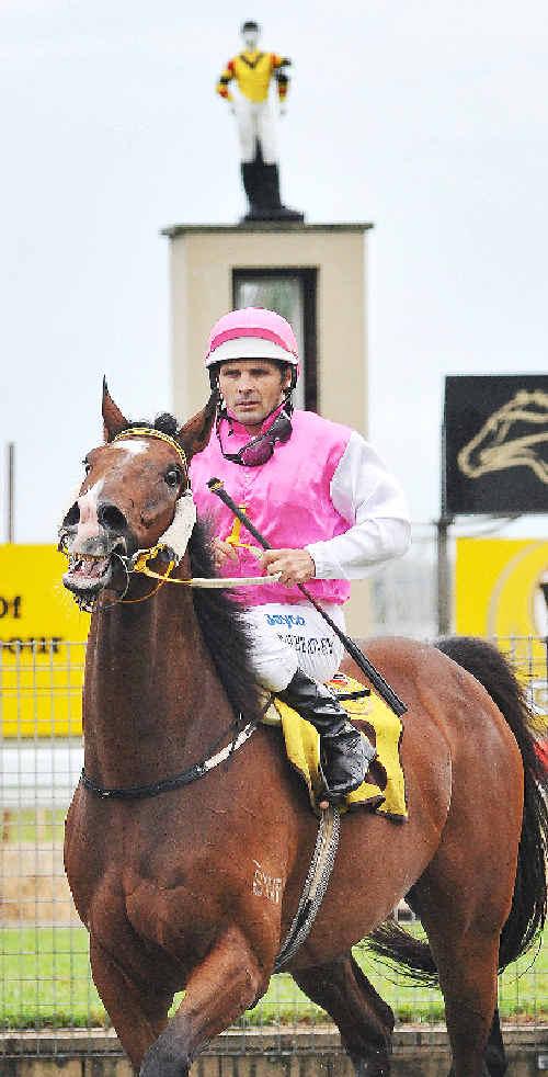 Jockey Wayne Wheatley returns to scale.