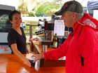 Red Dog owner operator Angel Hanson serves a Big Pineapple market customer with a take-away coffee.