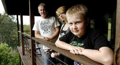 Ashley Mackinnon, of Wilsons Creek, with his children Rebecca Kinsella, 16, and Alec Mackinnon, 10.