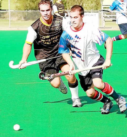 Southside's Chris Shipman holds out a Northern Beaches opponent in Friday's exciting game.