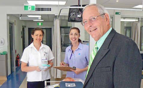 Third year student Miffy Pollard and Fresenius registered nurse Anita White with CEO of St Vincent's Hospital, Bob Walsh, in the new renal dialysis unit.