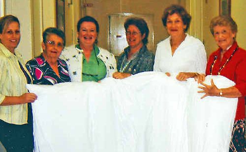 Showing off the Spenco mattresses are (l-r) Palliative Care Unit staff member Lisa Fayers, Blue & White Auxiliary vice president Anne Thompson, Palliative Care Unit staff members Jo Cooper and Cathy Lewis, and Blue & White Auxiliary president Annette Crimmins and secretary Una Kennedy.