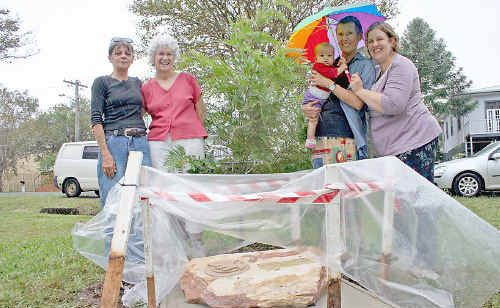 With the new plaque that has been laid in Peace Park for the Remembering and Healing Old Wounds ceremony on Anzac Day are (l-r) Kerry Reynolds and organisers Margaret Loong, Sabina Baltruweit and Larisa Barnes with Larisa's little girl Emanuella.