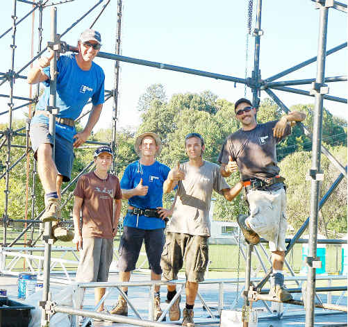The crew from Leo Bacala's LB Rigging assembling the stage for today's M.A.D.E festival at the Bellingen Showgrounds.