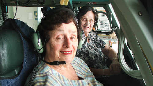 Lismore twins Emily and Mary Betteridge, tireless fundraisers for the Westpac Life Saver Rescue Helicopter, at the controls of one of the service's choppers.