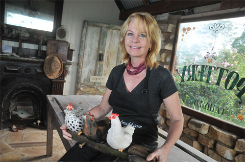 Cathy Lawley in her Maleny Studio with some of her magnificent pottery for
