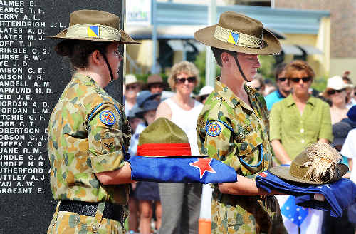 ABOVE: Unit 216 army cadets Jodi Summers and Brendan Parkes with the Australian and New Zealand flags and army hats at theLismore Cenotaph. Jacklyn Wagner