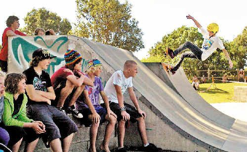 Skater Mitch Weston shows his moves at Crankfest in Evans Head on the weekend, watched by fellow skaters keen to check out the competition.