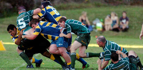 The SCU defence drag Lismore into touch in their match at the uni grounds on Saturday.