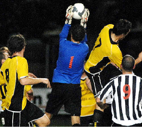 Byron Bay goalkeeper Kai Connell saves a shot on goal from Goonellabah in the Tursa Anzac Cup final at Oakes Oval, Lismore, last night.