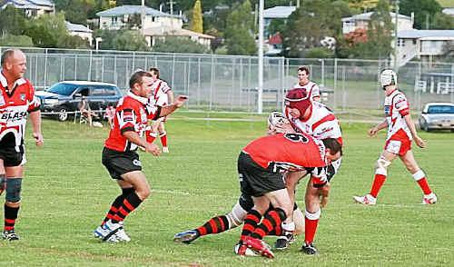 Killarney player John Bunch is tackled by Matt Gainey.