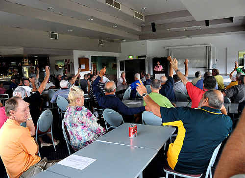 Show of hands: Members of the Gympie Pines Golf club vote against a levy to bail the club out of its financial problems at a special general meeting on Saturday.
