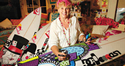 Nola Wilson with some of her son's (professional surfer Julian) surfboards.