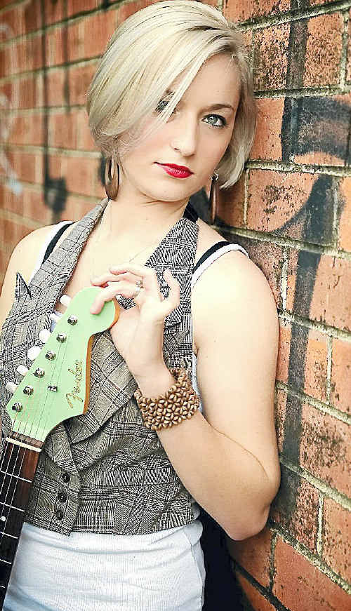 Jesse Emmanuel says 'it's insane' her single, Don't Touch My Guitar, has debuted in the Top 40 of the Country Music Channel Charts.
