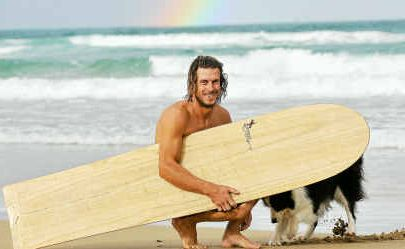 Teal Nippard and his hand-crafted Alaia surfboard.