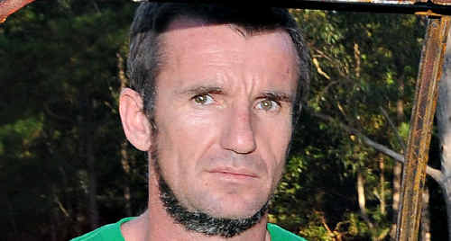 Gympie police take Allan Murray into custody on May 22 after Graeme Hughes was found dead in a Goomboorian bathtub.