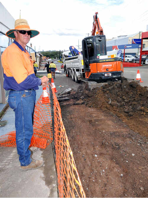 Council's Justin Cumner with new footpath, kerb and channel work on the corner of Monkland and Nash Streets.