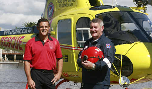 Westpac regional general manager Jason New welcomes chief pilot Peter Bird who will be patrolling Sunshine Coast beaches in the Westpac chopper.