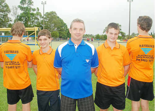 Young Gympie Hockey umpires (left to right) Jamie Austin, Mitchell Collins, Jared Parke and Joey Collins show off their new umpiring uniforms thanks to sponsor Peter Schutt (middle).