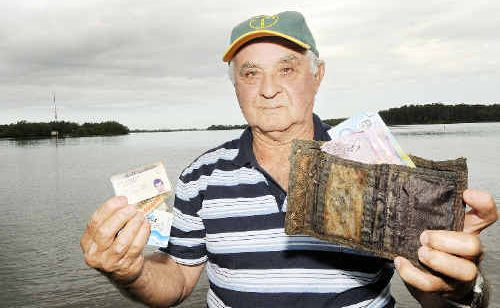 Bert Ranieri, of Alstonville, with the wallet and contents he fished out of the river in Ballina.