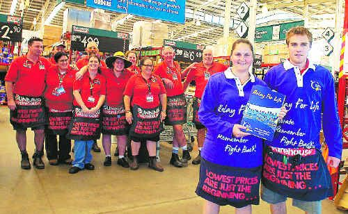 Rachel Spinaze and Ashley Waring (in front) are joining other Bunnings staff members parting part in this weekend's Lismore Relay for Life to raise money for the Cancer Council.
