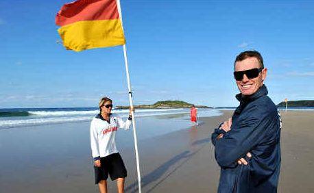 Lifeguards Matt Nolan and Temika Wright on duty at Park Beach yesterday.