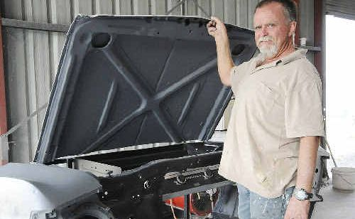 AUTOMOTIVE EXCELLENCE: Gary Shepherd with his partially-built barbecue constructed from the front end of an XY Ford Falcon.