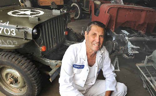 CAR LOVER: Bob Trevan, of Lismore, with the 1944 Ford jeep he bought last Saturday and used in Sunday's Lismore Anzac Day parade and the 1941 Willys jeep he is restoring.