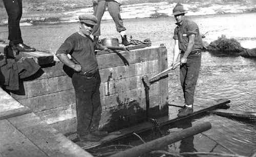Arthur Matthews, left, and another man work on the Forgan Bridge, which opened in 1938.