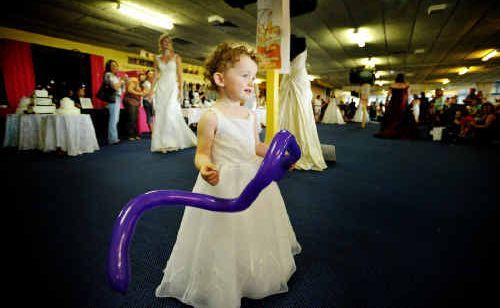 Amity Stevenson, 2, modelled this little flower girl's dress at the Bridal Expo at the Grafton racecourse.