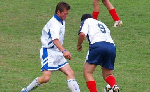 Grafton City Rhinos player Lee Stutt (left) tackles Nambucca.