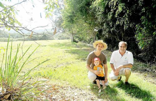 Adam Curlis, his son, Lenny, and David Wilson at the Englands Park site earmarked for Coffs Harbour's community garden.
