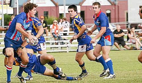 Warwick Cowboys player Luke Brosnan gets the ball away for Toowoomba.
