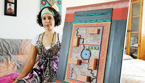 Nicole Wone is organising an Aboriginal art competition in Bundaberg. The artwork she is holding, titled Unity, is part of a two-piece work called Unity and Leadership.