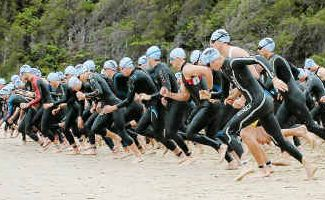Off and racing: Triathletes are about ot hit the water at the start of the Triathlon NSW Club Championships.