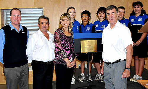 School pride: Opening the new hall, library and science centre at One Mile State School is (above, from left) Reed Construction's William Burns and Dave McClaire, principal Janelle Reid, school leaders Bethany Nelson, Mason McGlone, Adam Track, Benjamin Martin and Alysha Wellman with Senator John Hogg.