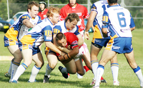 The Red Devils surge for the line against the Murwillumbah Mustangs on Sunday.