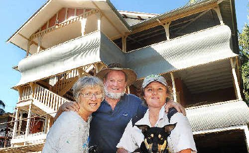 Carol and Charlie Evans with their daughter Lexie Gold holding pet dog Brumby outside their heritage listed home in Coleman Street, Lismore.