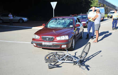 Ouch: A cyclist was taken to hospital after a tangle with a car on the Pacific Highway yesterday.