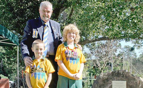 Eltham students George Cooper and Ellen Payne with City of Lismore RSL Sub-Branch secretary Wilson McClelland.