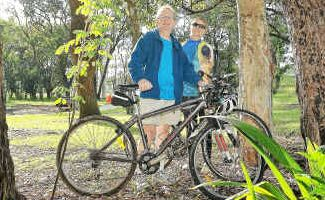 Great place: Coffs Ambassadors Ian Scott and Wendy Frost in bushland at Toormina.