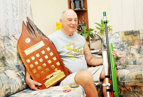 John Radford with his impressive title trophy.