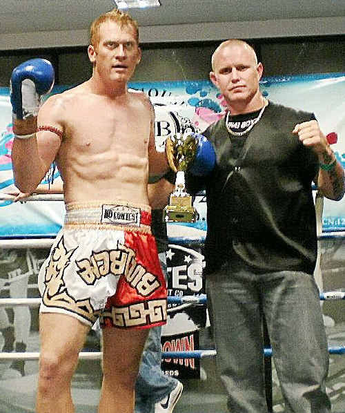 Gympie kickboxer Beau Badior is congratulated by trainer Billy Degoumois following his inspiring victory in Brisbane last weekend.