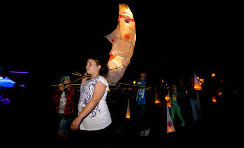 Students from Finch Hatton State School show off their lanterns at the opening of The River Rock to Mountain Top Community Festival last night.