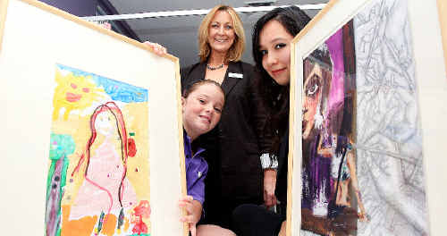 World of colour: Operation Art's Fiona Steel with young artists Breanna Schultz and Molly Tiamso.