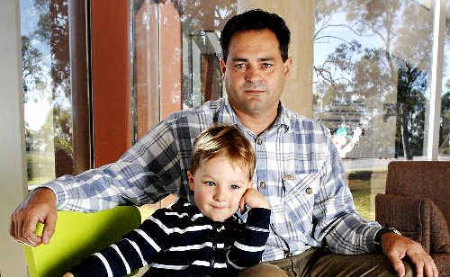 Keep it open: Brett Anderson, with his three-year-old son Mitchell who attends Lismore City Council's Koala Child Care Centre, is urging council not to close the facility.