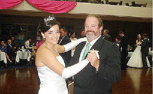 Debs waltz: Debutante Claire Stead dances with her father, Shaun, at the Southern Cross LADS Debutante Ball at the Lismore Workers Club.