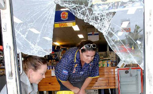 Teneille Driver, left, and Lucky 7 Kimberley Estate mini-mart manager Jo King inspect the damage caused during a bungled ATM theft.