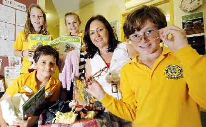 Helping hand: Wollongbar Public School captain Jack McCabe (far left) organised an appeal for clothes, books and eyeglasses to be sent to Papua New Guinea. He is pictured with (from left) fellow captains Caylene Withers, Chloe Hughes, principal Jennifer Thomas and Nic Alcorn.