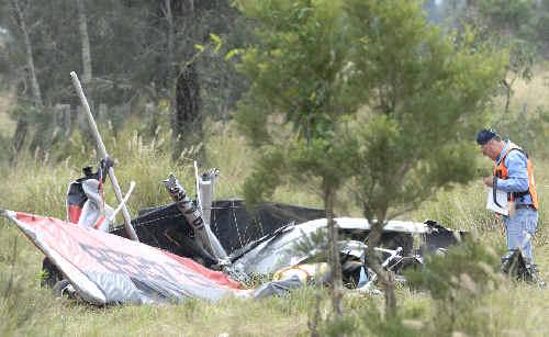 Clues: Recreational Aviation Investigator at the crash site of Friday's ultralight crash near Tatham.